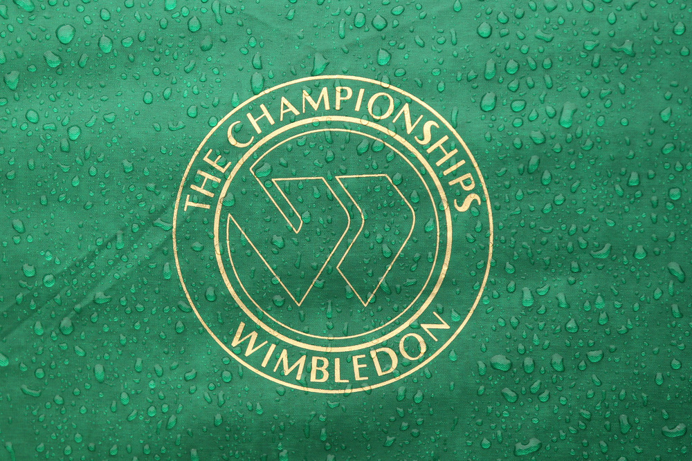 LONDON, ENGLAND - JUNE 20:  A rain soaked logo on Day One of the Wimbledon Lawn Tennis Championships at the All England Lawn Tennis and Croquet Club on June 20, 2011 in London, England.  (Photo by Oli Scarff/Getty Images)