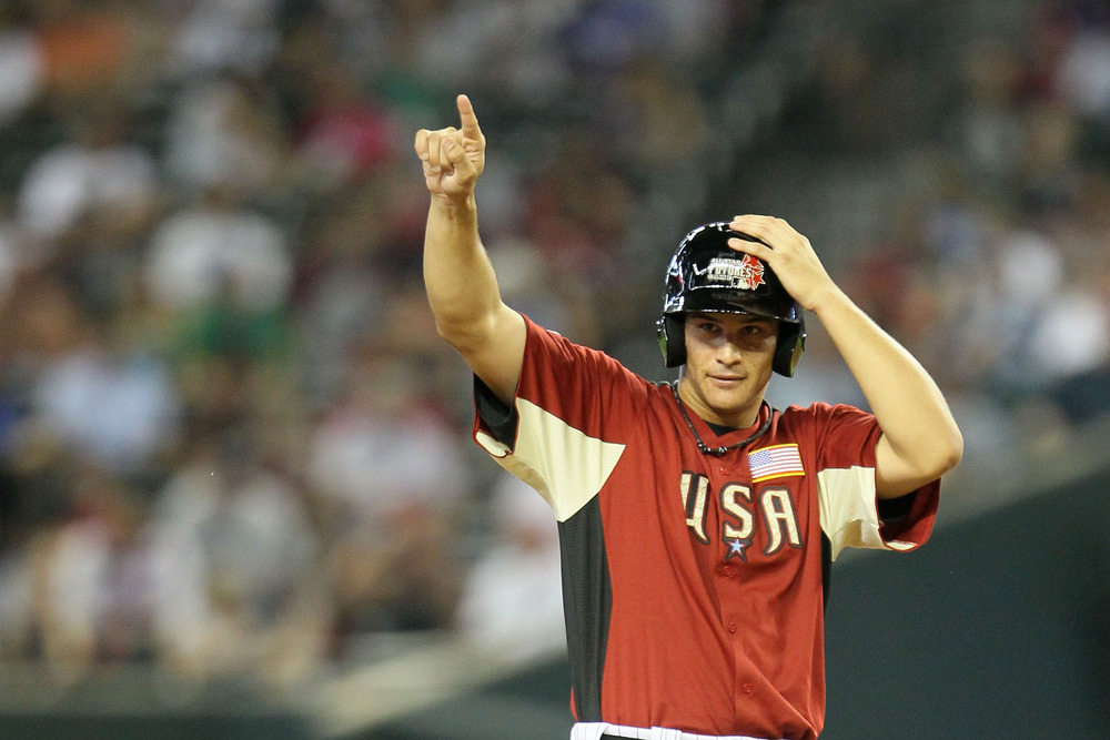 PHOENIX, AZ - JULY 10:  U.S. Futures All-Star Nolan Arenado #12 of the Colorado Rockies stands on base during the 2011 XM All-Star Futures Game at Chase Field on July 10, 2011 in Phoenix, Arizona.  (Photo by Jeff Gross/Getty Images)