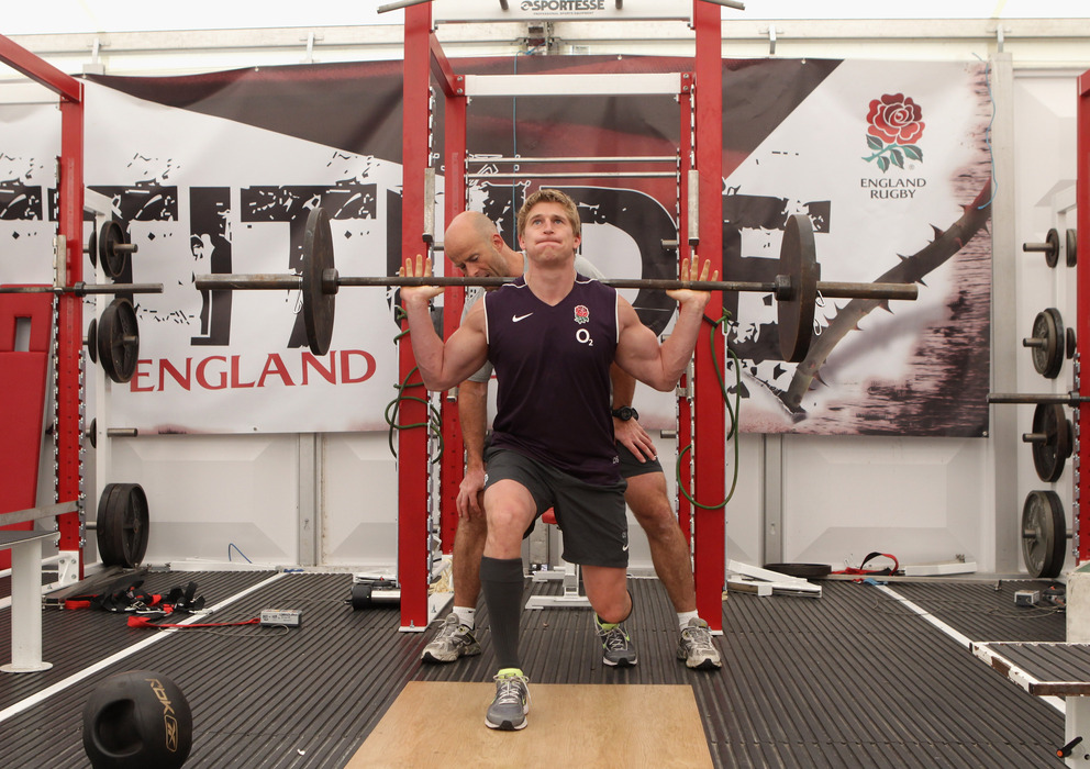 BAGSHOT, ENGLAND - JULY 20:  David Strettle lifts a weight bar during the England training and weights session held at Pennyhill Park on July 20, 2011 in Bagshot, England.  (Photo by David Rogers/Getty Images)