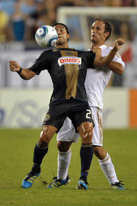 PHILADELPHIA, PA - JULY 23: Carlos Ruiz #20 of the Philadelphia Union and Ricardo Carvalho #2 of Real Madrid battle for the ball at Lincoln Financial Field on July 23, 2011 in Philadelphia, Pennsylvania. (Photo by Drew Hallowell/Getty Images)