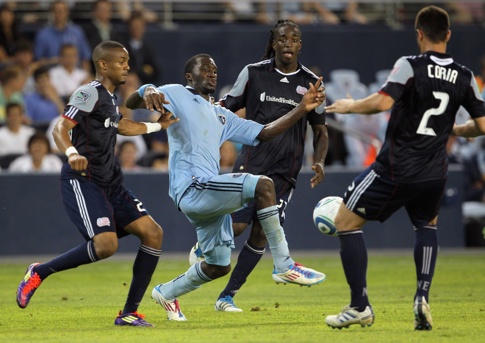 KANSAS CITY, KS - JULY 30:  C.J. Sapong #17 of Sporting Kansas City controls the ball through New England Revolution defenders during the game on July 30, 2011 at LiveStrong Sporting Park in Kansas City, Kansas.  (Photo by Jamie Squire/Getty Images)