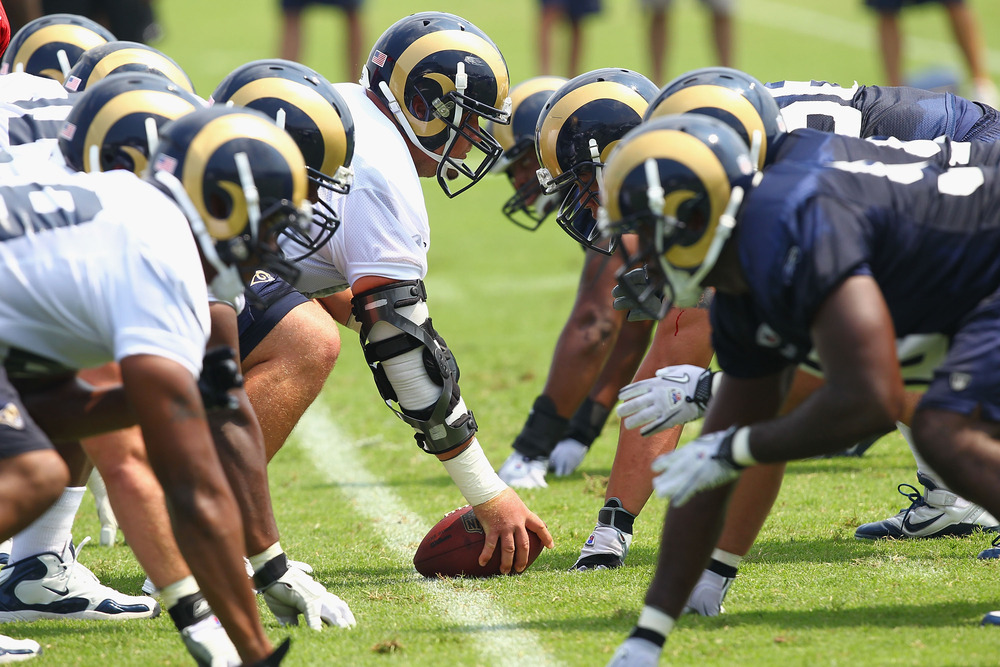 EARTH CITY, MO - JULY 31:  Members of the St. Louis Rams offense and defense line up against each other during training camp at the Russell Training Center on July 31, 2011 in Earth City, Missouri.  (Photo by Dilip Vishwanat/Getty Images)