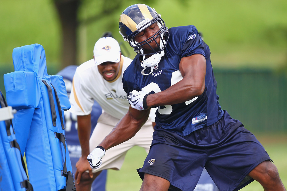 EARTH CITY, MO - JULY 31:  Robert Quinn #94 of the St. Louis Rams works with a trainer during training camp at the Russell Training Center on July 31, 2011 in Earth City, Missouri.  (Photo by Dilip Vishwanat/Getty Images)