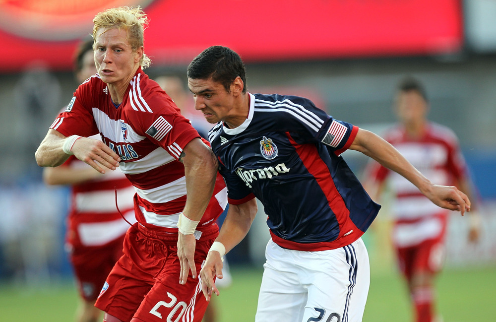 FRISCO, TX - JULY 31:  Brek Shea #20 of the FC Dallas dribbles the ball against Zarek Valentin #20 of the Chivas USA at Pizza Hut Park on July 31, 2011 in Frisco, Texas.  (Photo by Ronald Martinez/Getty Images)