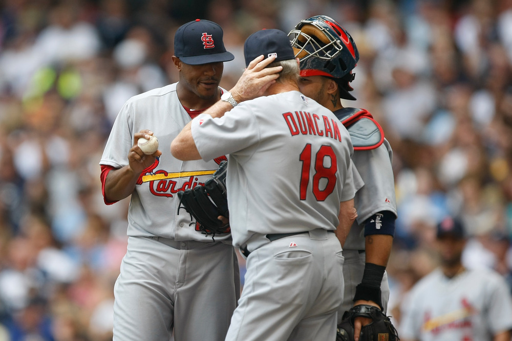 MILWAUKEE, WI - AUGUST 03: Edwin Jackson #22 of the St. Louis Cardinals talks with Yadier Molina #4 and Dave Duncan #18 against the Milwaukee Brewers at Miller Park on August 3, 2011 in Milwaukee, Wisconsin. (Photo by Scott Boehm/Getty Images)