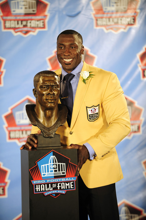CANTON, OH - AUGUST 6:  Former Denver Broncos tight end Shannon Sharp poses with his bust at the Enshrinement Ceremony for the Pro Football Hall of Fame on August 6, 2011 in Canton, Ohio.  (Photo by Jason Miller/Getty Images)