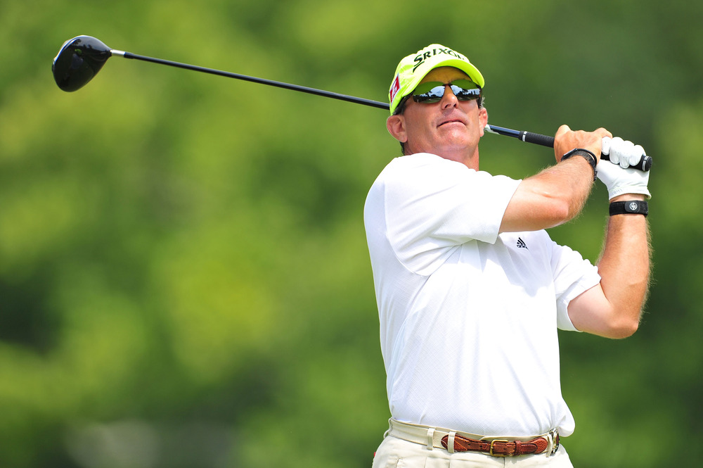 JOHNS CREEK, GA - AUGUST 11:  Brian Cairns hits a shot during the first round of the 93rd PGA Championship at the Atlanta Athletic Club on August 11, 2011 in Johns Creek, Georgia.  (Photo by Stuart Franklin/Getty Images)