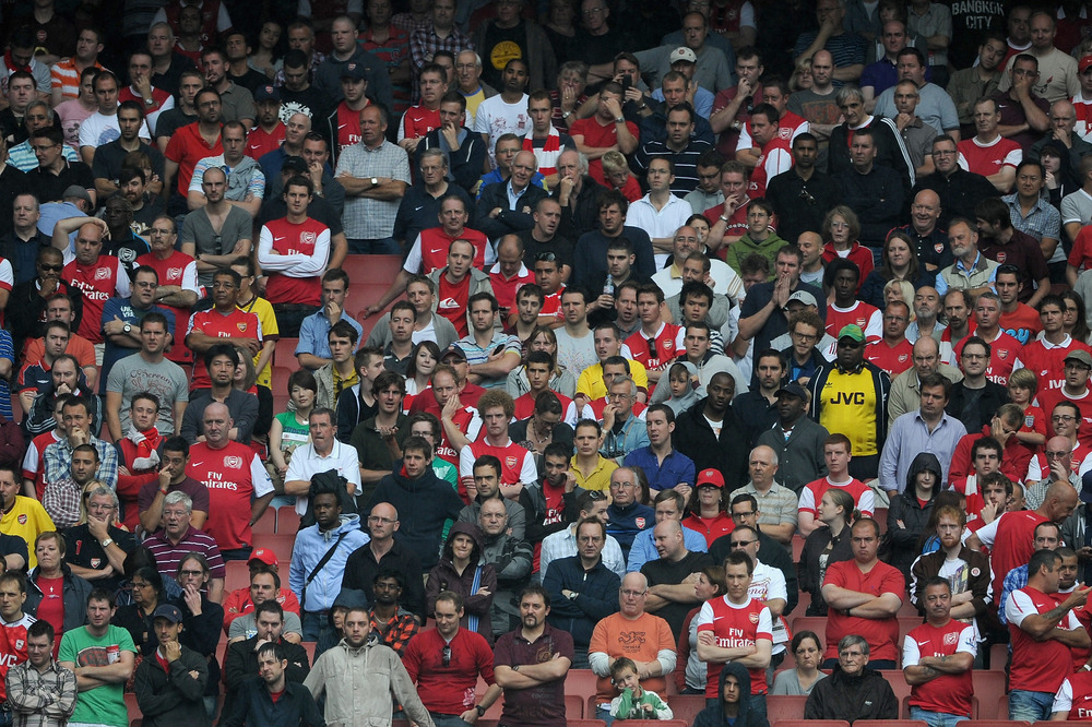 LONDON, ENGLAND - AUGUST 20:  Dejected Arsenal fans during defeat in the Barclays Premier League match between Arsenal and Liverpool at the Emirates Stadium on August 20, 2011 in London, England.  (Photo by Michael Regan/Getty Images)