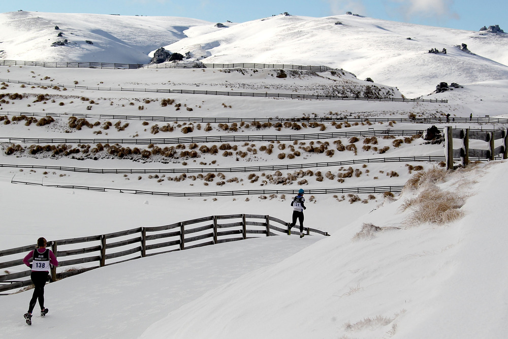 WANAKA, NEW ZEALAND - AUGUST 27:  Competitors run in the Winter Triathlon during day 15 of the Winter Games NZ at Snow Farm on August 27, 2011 in Wanaka, New Zealand.  (Photo by Camilla Stoddart/Getty Images)