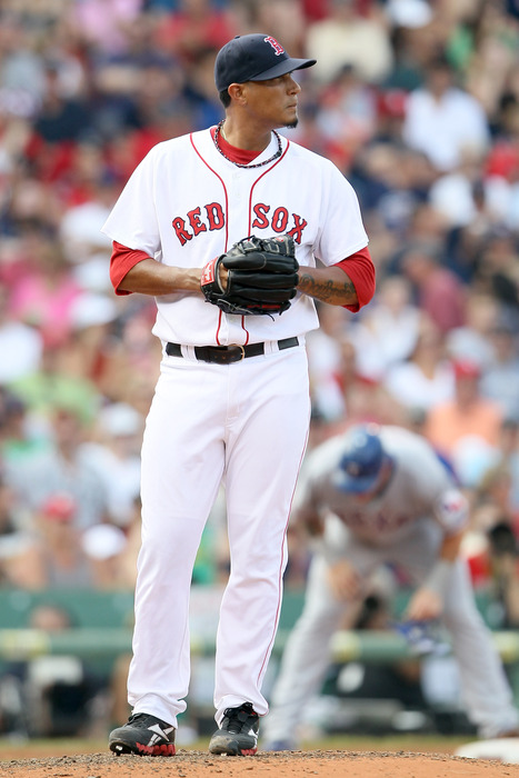 Felix Doubront of the Boston Red Sox looks on after he gave up a triple to Josh Hamilton of the Texas Rangers in the sixth inning at Fenway Park in Boston, Massachusetts.  (Photo by Elsa/Getty Images)