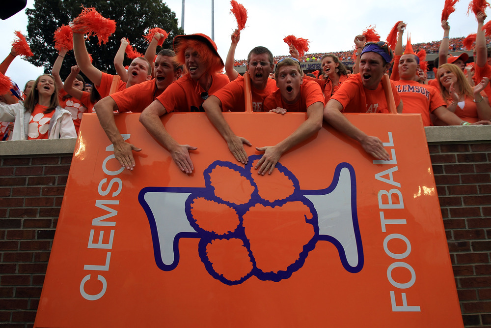 CLEMSON, SC - SEPTEMBER 17:  Fans of the Clemson Tigers cheer on their team against the Auburn Tigers at Memorial Stadium on September 17, 2011 in Clemson, South Carolina.  (Photo by Streeter Lecka/Getty Images)