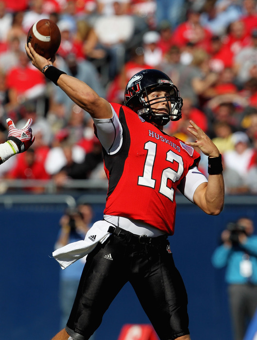 CHICAGO, IL - SEPTEMBER 17: Chandler Harnish #12 of the Northern Illinois Huskies throws a pass against the Wisconsin Badgers at Soldier Field on September 17, 2011 in Chicago, Illinois. (Photo by Jonathan Daniel/Getty Images)