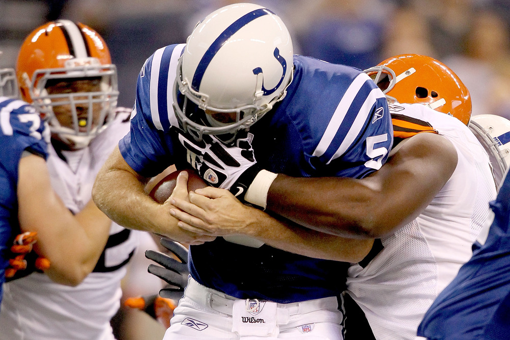 INDIANAPOLIS, IN - SEPTEMBER 18:  Kerry Collins #5 of the Indianapolis Colts is sacked by Artis Hicks #75 of the Cleveland Browns  at Lucas Oil Stadium on September 18, 2011 in Indianapolis, Indiana.  (Photo by Matthew Stockman/Getty Images)