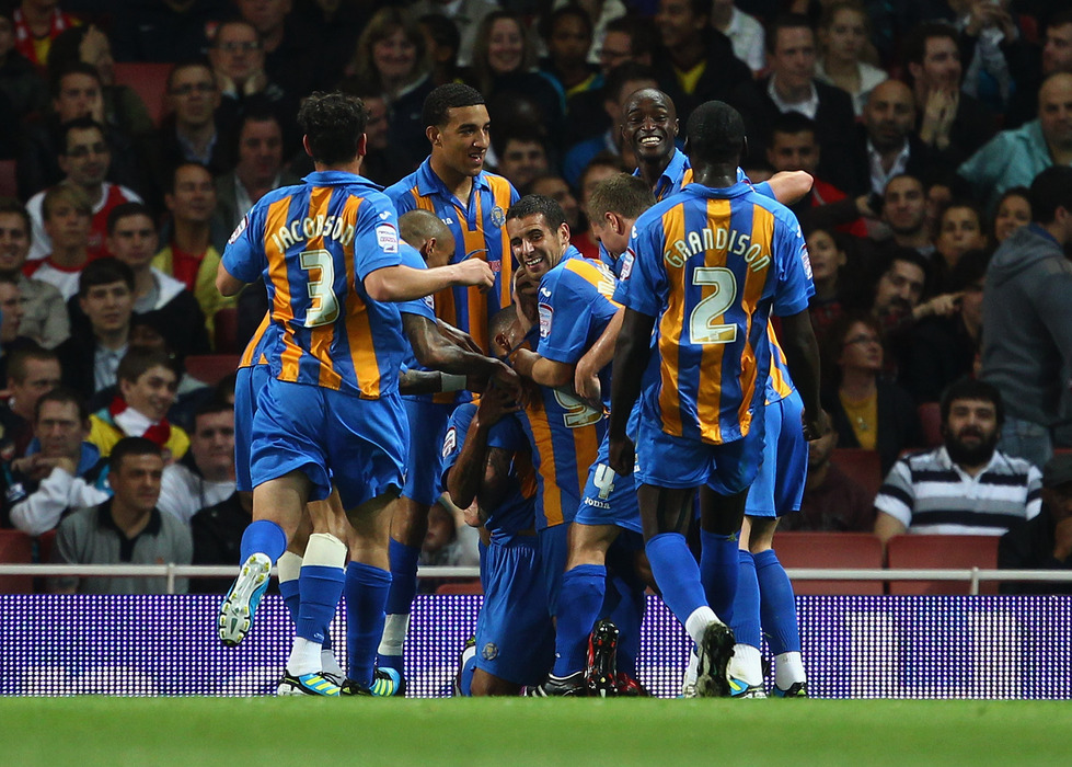 Shrewsbury celebrate their goal at the Emirates during last season's competition. (Photo by Julian Finney/Getty Images)
