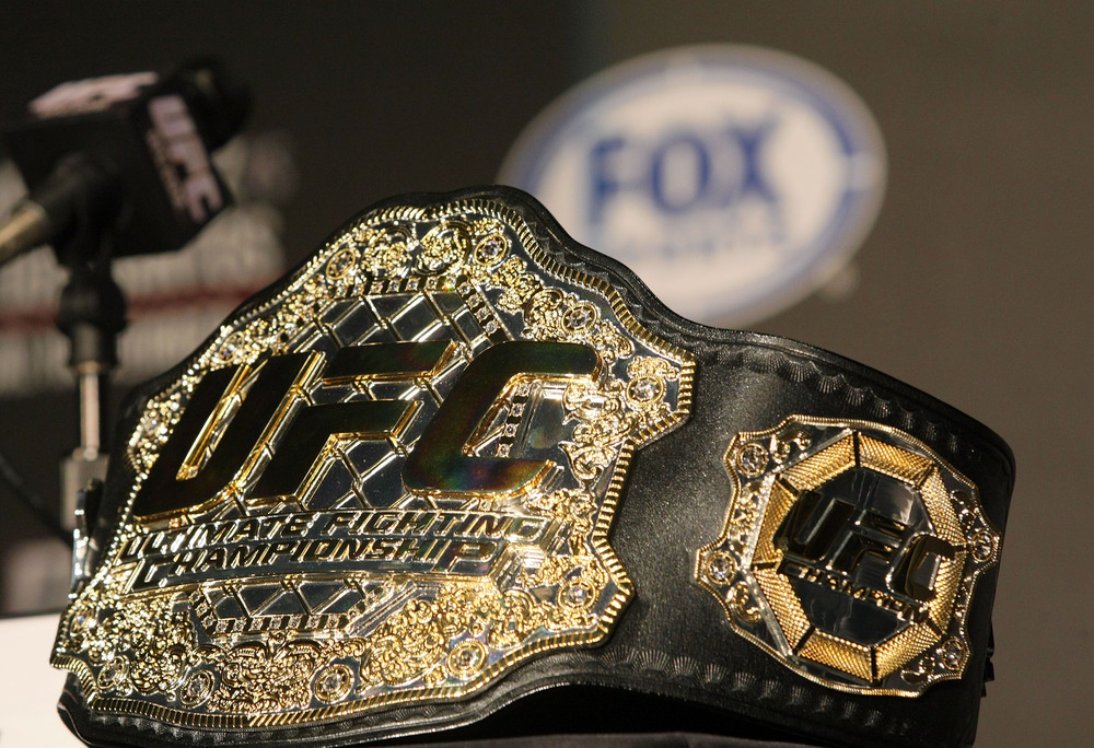 HOLLYWOOD, CA:  A detailed view of the UFC Championship belt prior to the UFC on Fox: Velasquez v Dos Santos - Press Conference at W Hollywood in Hollywood, California.  (Photo by Victor Decolongon/Getty Images)