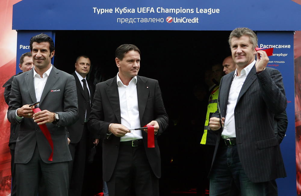Luis Figo, Dmitri Alenichev and Davor Suker cut tape during opening ceremony of the UEFA Champions League Trophy Tour 2011 in Moscow, Russia.  (Photo by Dmitry Korotayev/Epsilon/Getty Images)