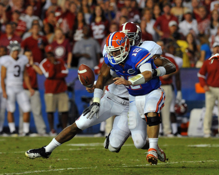 GAINESVILLE, FL -  OCTOBER 1:  Quarterback John Brantley #12 of the Florida Gators is sacked by the Alabama Crimson Tide October 1, 2011 at Ben Hill Griffin Stadium in Gainesville, Florida.  (Photo by Al Messerschmidt/Getty Images)