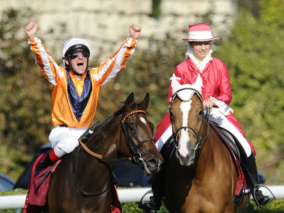 LONGCHAMP, FRANCE - OCTOBER 02:  Andrasch Starke riding Danedream wins the Qatar Prix De L'Arc De Triomphe at Longchamp racecourse on October 2, 2011 in Paris, France. (Photo by Alan Crowhurst/Getty Images)
