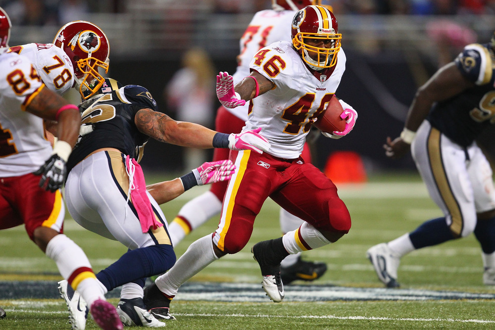 ST. LOUIS, MO - OCTOBER 2:  Ryan Torain #46 of the Washington Redskins rushes against the St. Louis Rams at the Edward Jones Dome on October 2, 2011 in St. Louis, Missouri.  The Redskins beat the Rams 17-10.  (Photo by Dilip Vishwanat/Getty Images)