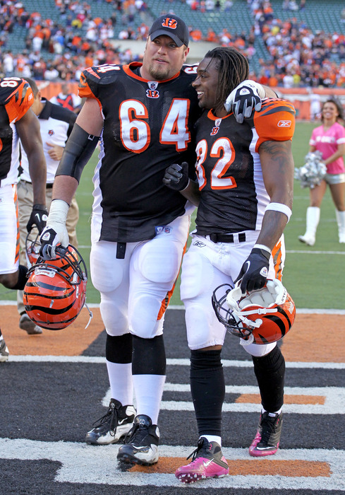 Kyle Cook #64  and Cedric Benson #32 celebrate after the 23-20 victory against the Buffalo Bills on October 2, 2011 in Cincinnati.  (Photo by Andy Lyons/Getty Images)