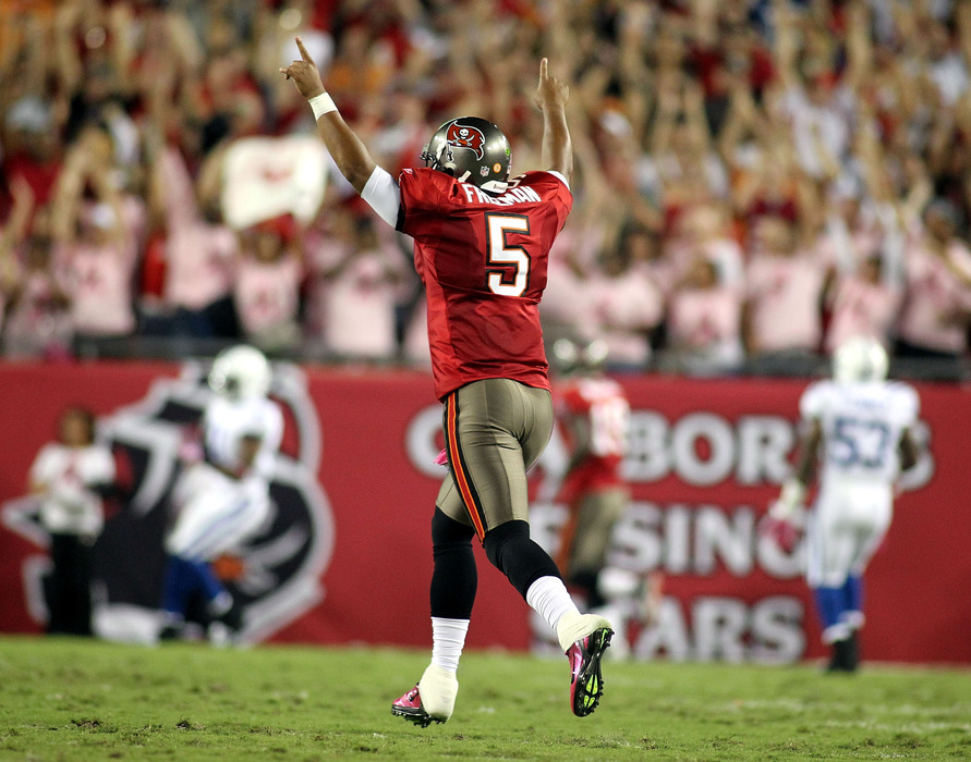TAMPA, FL - OCTOBER 03:  Quarterback Josh Freeman #5 of the Tampa Bay Buccaneers celebrates against the Indianapolis Colts at Raymond James Stadium on October 3, 2011 in Tampa, Florida.  (Photo by Marc Serota/Getty Images)