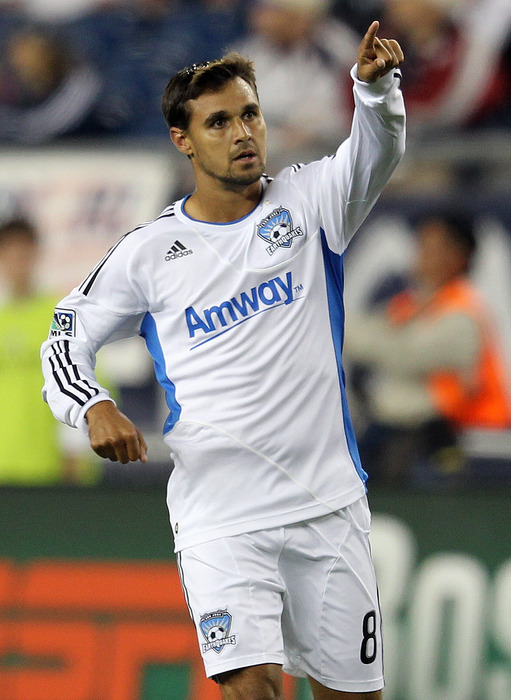 FOXBORO, MA - OCTOBER 8:  Chris Wondolowski #8 of the San Jose Earthquakes reacts after scoring a goal against the New England Revolution at Gillette Stadium on October 8, 2011 in Foxboro, Massachusetts. (Photo by Jim Rogash/Getty Images)