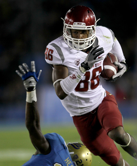 PASADENA, CA - OCTOBER 8: Wide receiver Marquess Wilson #86 of the Washington State Cougars carries the ball against the UCLA Bruins at the Rose Bowl on October 8, 2011 in Pasadena, California.   (Photo by Stephen Dunn/Getty Images)