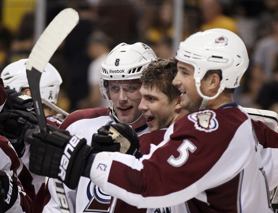 BOSTON, MA - OCTOBER 10:  Semyon Varlamov #1 of the Colorado Avalanche laughs after Jan Hejda #8 asks if he thinks Shane O'Brien #5 will be signed for 2012-2013. (Photo by Elsa/Getty Images)