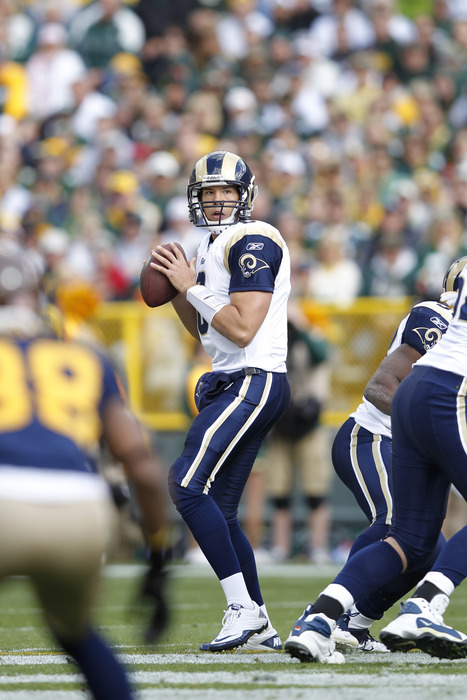 GREEN BAY, WI - OCTOBER 16: Sam Bradford #8 of the St. Louis Rams looks to pass against the Green Bay Packers at Lambeau Field on October 16, 2011 in Green Bay, Wisconsin. The Packers won 24-3. (Photo by Joe Robbins/Getty Images)