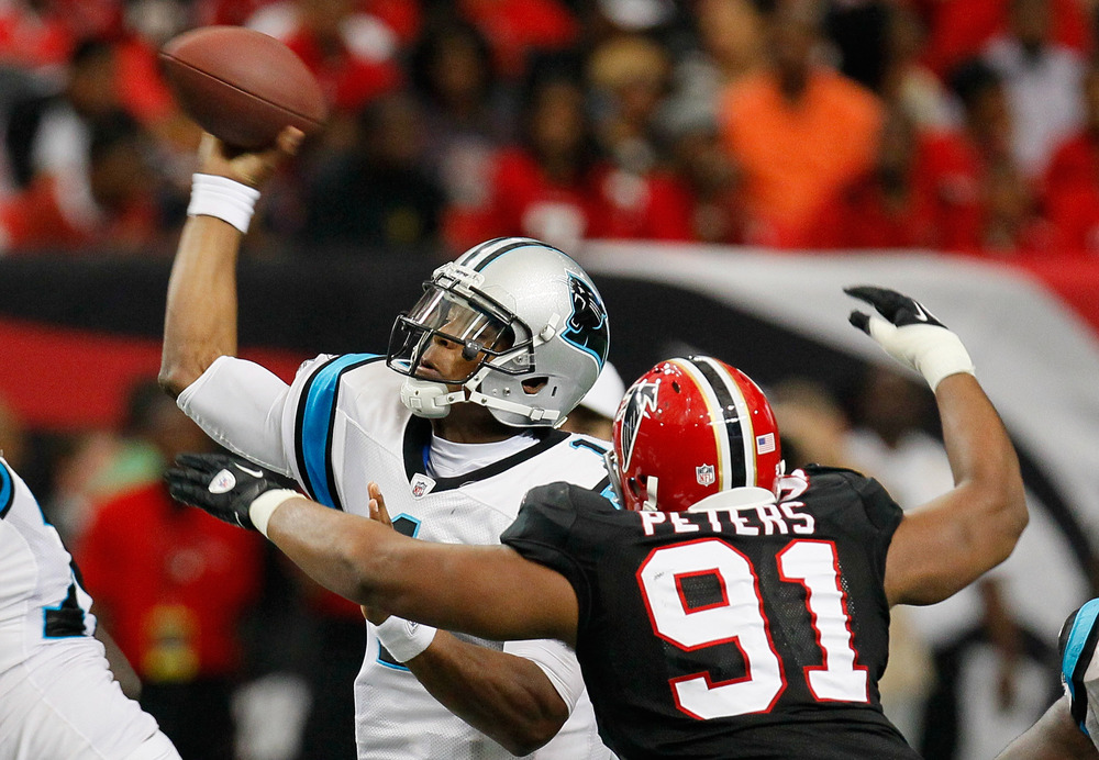 ATLANTA, GA - OCTOBER 16:  Cam Newton #1 of the Carolina Panthers is pressured by Corey Peters #91 of the Atlanta Falcons at Georgia Dome on October 16, 2011 in Atlanta, Georgia.  (Photo by Kevin C. Cox/Getty Images)
