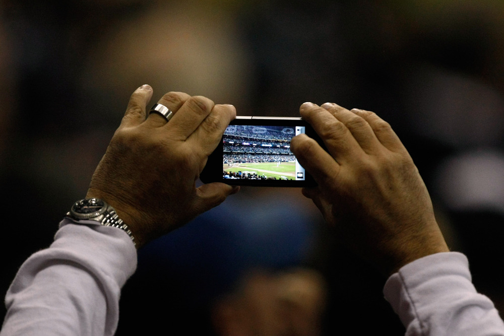 MILWAUKEE, WI - OCTOBER 16:  An anonymous fan clearly Instagraming.  (Photo by Scott Boehm/Getty Images)