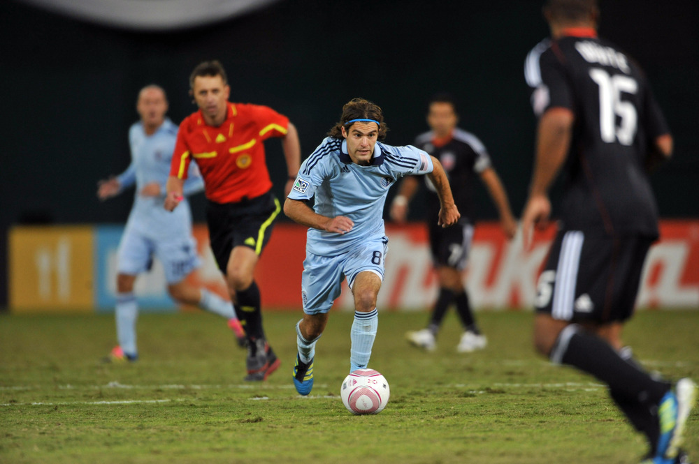 WASHINGTON, DC - OCTOBER 22:  Graham Zusi #8 of Sporting Kansas City moves the ball against D.C. United at RFK Stadium on October 22, 2011 in Washington, DC. Sporting Kansas City defeated D.C United 1-0. (Photo by Larry French/Getty Images)