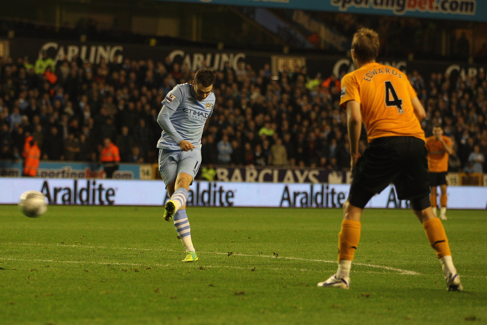 WOLVERHAMPTON, ENGLAND - OCTOBER 26:  Adam Johnson (L) of Manchester scores his sides first goal during the Carling Cup Fourth Round match at Molineux on October 26, 2011 in Wolverhampton, England.  (Photo by Michael Steele/Getty Images)