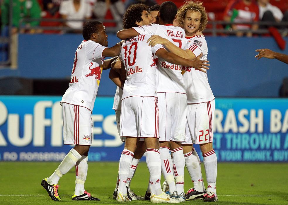 FRISCO, TX - OCTOBER 26: The New York Red Bulls celebrate a goal by Joel Lindpere #20 against FC Dallas during a wild card match at Pizza Hut Park on October 26, 2011 in Frisco, Texas.  (Photo by Ronald Martinez/Getty Images)