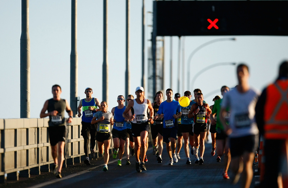 AUCKLAND, NEW ZEALAND - OCTOBER 30:  Competitors cross the Auckland Harbour Bridge during the 2011 Auckland Marathon on October 30, 2011 in Auckland, New Zealand.  (Photo by Simon Watts/Getty Images)