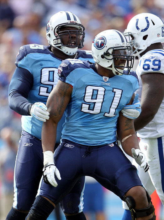 NASHVILLE, TN - OCTOBER 30:  Jason Jones #91 of the Tennessee Titans celebrates with Shaun Smith #93 during the NFL game against the Indianapolis Colts at LP Field on October 30, 2011 in Nashville, Tennessee.  (Photo by Andy Lyons/Getty Images)