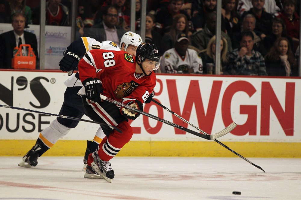 CHICAGO, IL - OCTOBER 31: Patrick Kane #88 of the Chicago Blackhawks breaks to the puck next to Kevin Klein #8 of the Nashville Predators at the United Center on October 31, 2011 in Chicago, Illinois. (Photo by Jonathan Daniel/Getty Images)