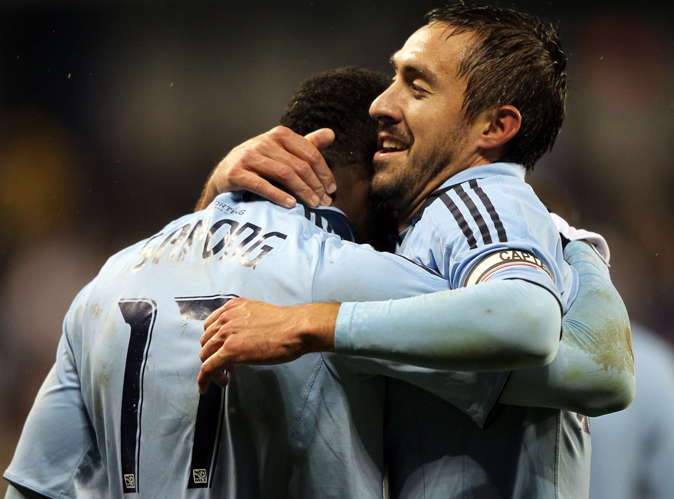 Davy Arnaud (right) was on the field to celebrate CJ Sapong's 76th minute header to put Sporting KC up 2-0 Wednesday night, but we haven't seen nearly as much of Arnaud as of late.  (Photo by Jamie Squire/Getty Images)