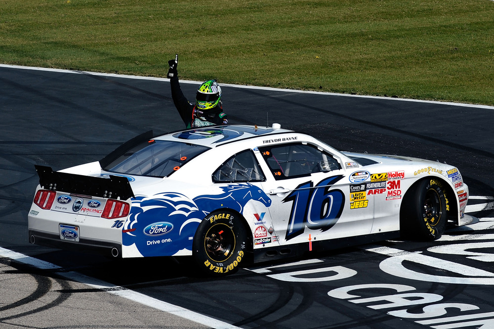 Trevor Bayne celebrates after winning the NASCAR Nationwide Series O'Reilly Auto Parts Challenge at Texas Motor Speedway.