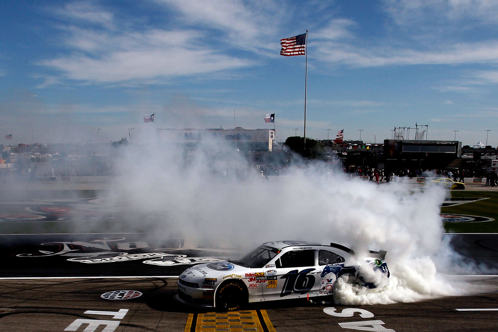 Trevor Bayne performs a burnout in celebration of winning the NASCAR Nationwide Series O'Reilly Auto Parts Challenge at Texas Motor Speedway.