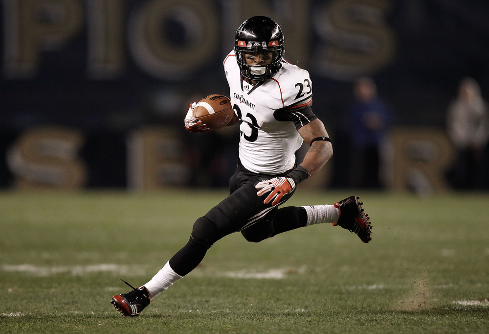 PITTSBURGH, PA - NOVEMBER 05:  Isaiah Pead #23 of the Cincinnati Bearcats runs with the ball against the Pittsburgh Panthers on November 5, 2011 at Heinz Field in Pittsburgh, Pennsylvania.  (Photo by Jared Wickerham/Getty Images)
