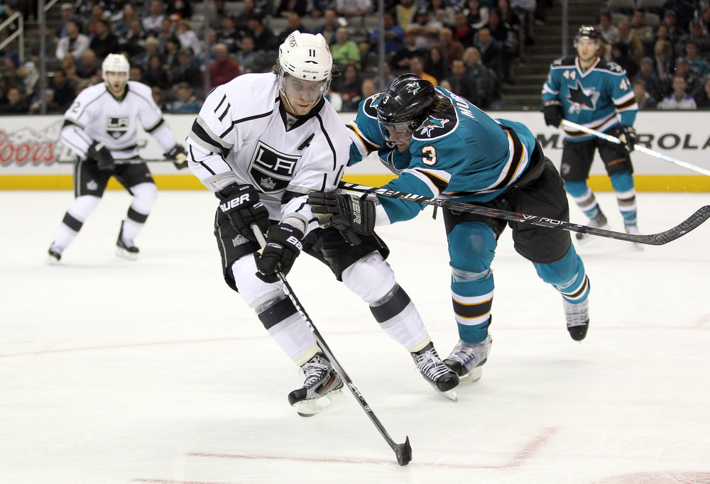 SAN JOSE, CA - NOVEMBER 07:  Douglas Murray #3 of the San Jose Sharks and Anze Kopitar #11 of the Los Angeles Kings go for the puck at HP Pavilion at San Jose on November 7, 2011 in San Jose, California.  (Photo by Ezra Shaw/Getty Images)