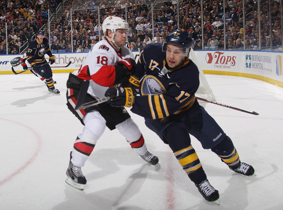 BUFFALO, NY - NOVEMBER 11: Jesse Winchester #18 of the Ottawa Senators checks Marc-Andre Gragnani #17 of the Buffalo Sabres at the First Niagara Center on November 11, 2011 in Buffalo, New York.  (Photo by Bruce Bennett/Getty Images)