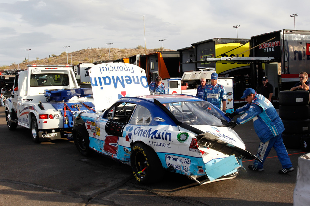 The car of Elliott Sadler is towed to the garage after a crash during the NASCAR Nationwide Series Wypall 200 at Phoenix International Raceway.