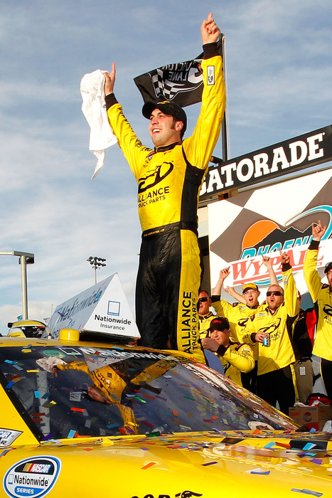 Sam Hornish Jr. celebrates in victory lane after winning the NASCAR Nationwide Series Wypall 200 at Phoenix International Raceway.