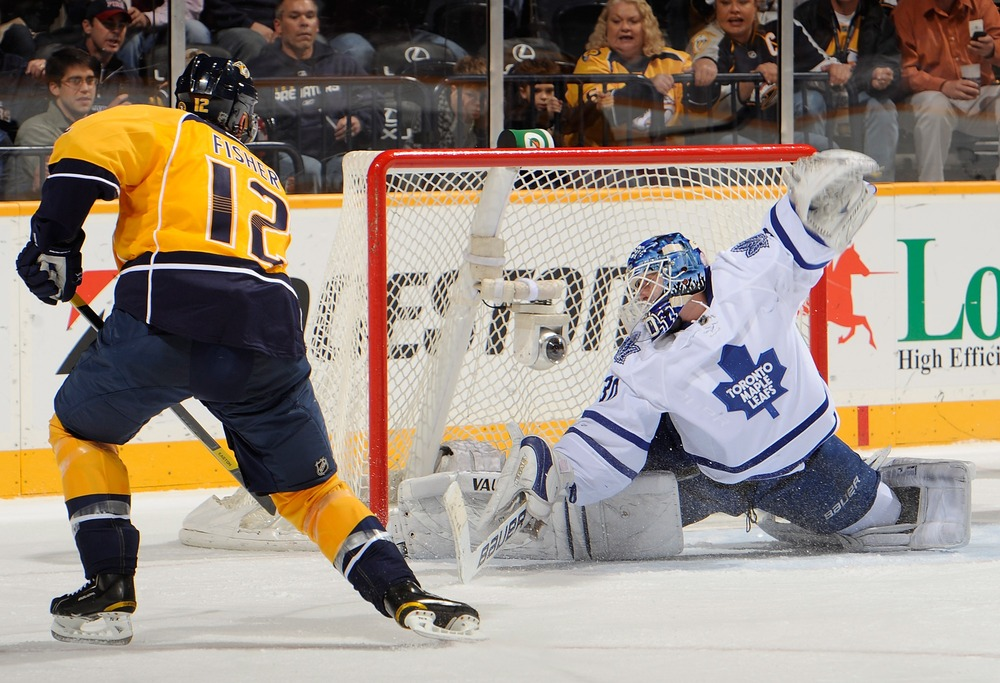 NASHVILLE, TN - NOVEMBER 17:  Ben Scrivens #30 of the Toronto Maple Leafs makes a save on Mike Fisher #12 of the Nashville Predators at Bridgestone Arena on November 17, 2011 in Nashville, Tennessee.  (Photo by Frederick Breedon/Getty Images)