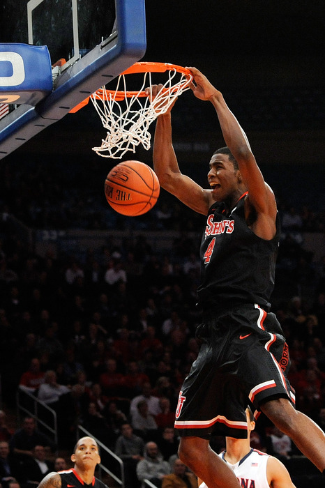 Moe Harkless of the St. John's Red Storm makes a dunk against Arizona Wildcats during the 2K Sports Classic Benefiting Coaches Vs Cancer at Madison Square Garden on November 17, 2011 in New York City.  (Photo by Patrick McDermott/Getty Images)