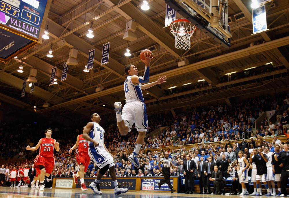 DURHAM, NC - NOVEMBER 18:  Austin Rivers #0 of the Duke Blue Devils drives to the basket against the Davidson Wildcats during their game at Cameron Indoor Stadium on November 18, 2011 in Durham, North Carolina.  (Photo by Streeter Lecka/Getty Images)