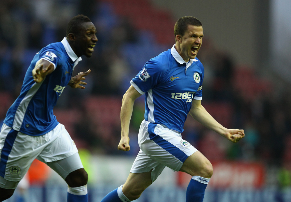 Gary Caldwell of Wigan celebrates scoring with a header during the Barclays Premier League match between Wigan Athletic and Blackburn Rovers at the DW Stadium.