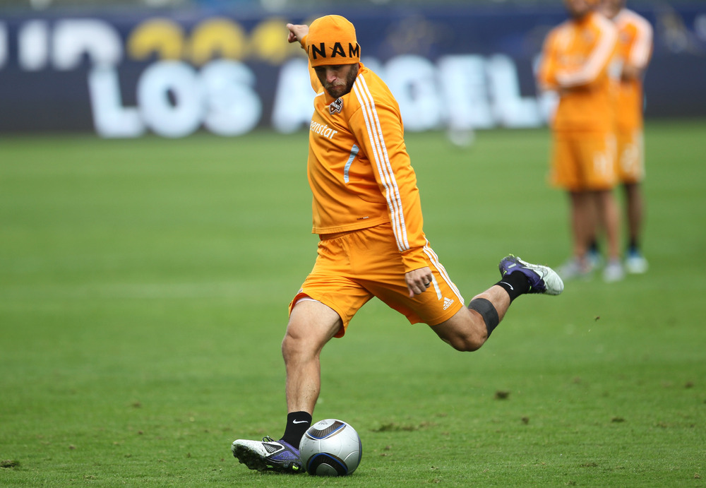 CARSON, CA - NOVEMBER 19: Colin Clark #7 of the Houston Dynamo takes a shot during a training session ahead of the MLS Cup at The Home Depot Center on November 19, 2011 in Carson, California.  (Photo by Stephen Dunn/Getty Images)